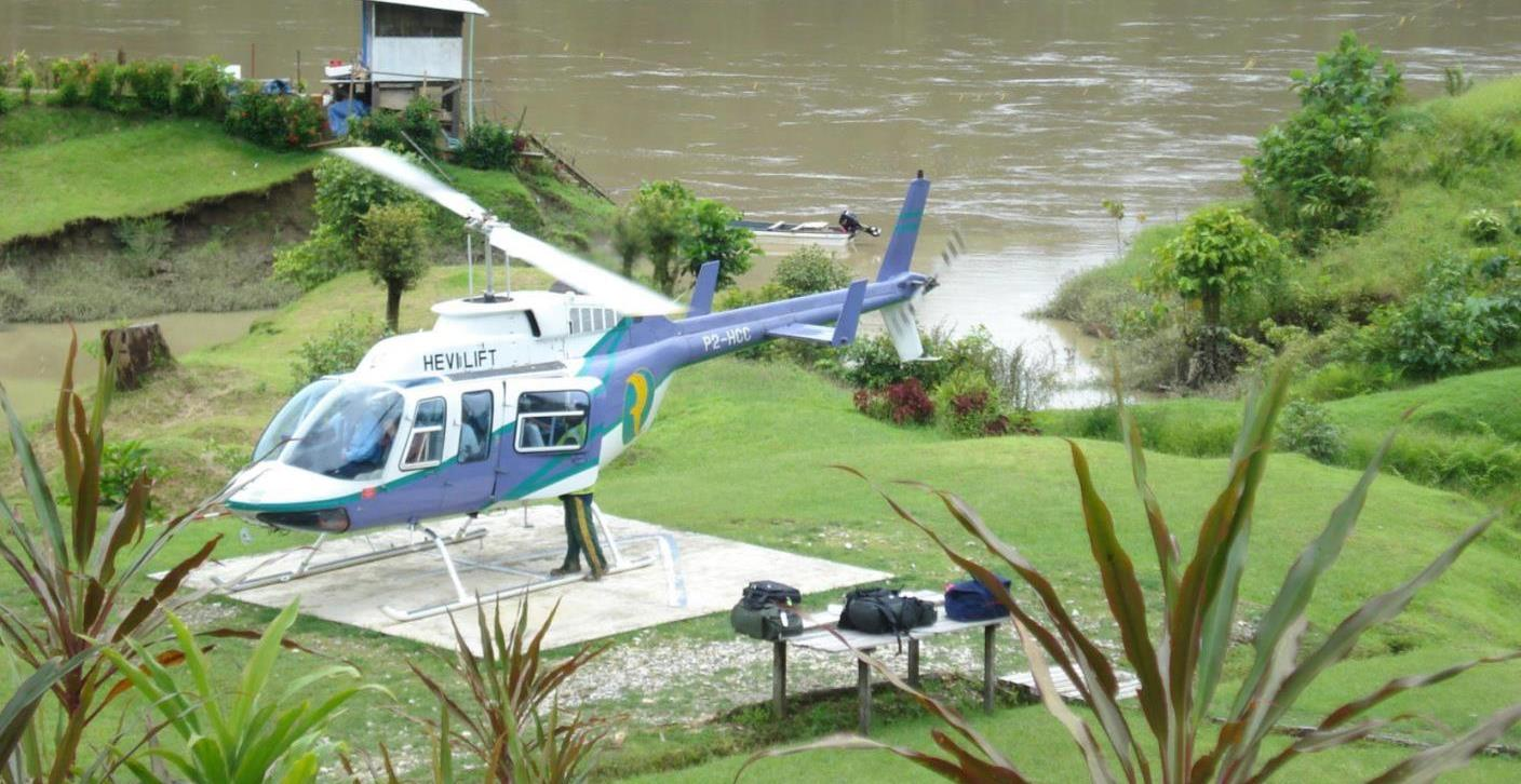 Helicopter on pad near river