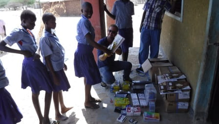 Handing out school supplies at Nakukulas primary school
